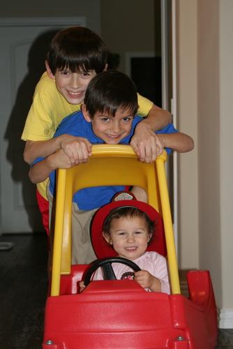 3 kids on car